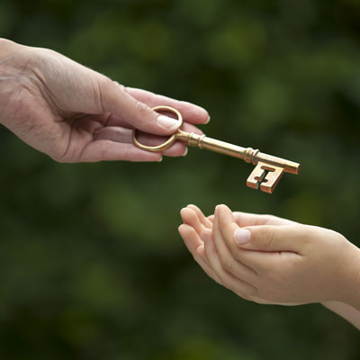 Adult giving inheritance key to a child